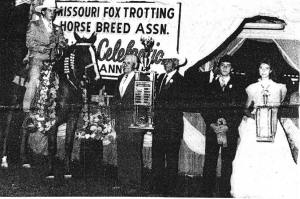The 1986 World Champion Missouri Fox Trotter is Madam Sensation; owned by Spencer (Pop) Jenkins (fourth from right), Sedalia, Mo., and ridden to victory Saturday night by Geno Middleton, Nixa, Mo. Presenting the Charlotte Dampier Memorial Trophy to  Jenkins is Dale Esther, president of the Missouri Fox Trotting Horse Breed Association.